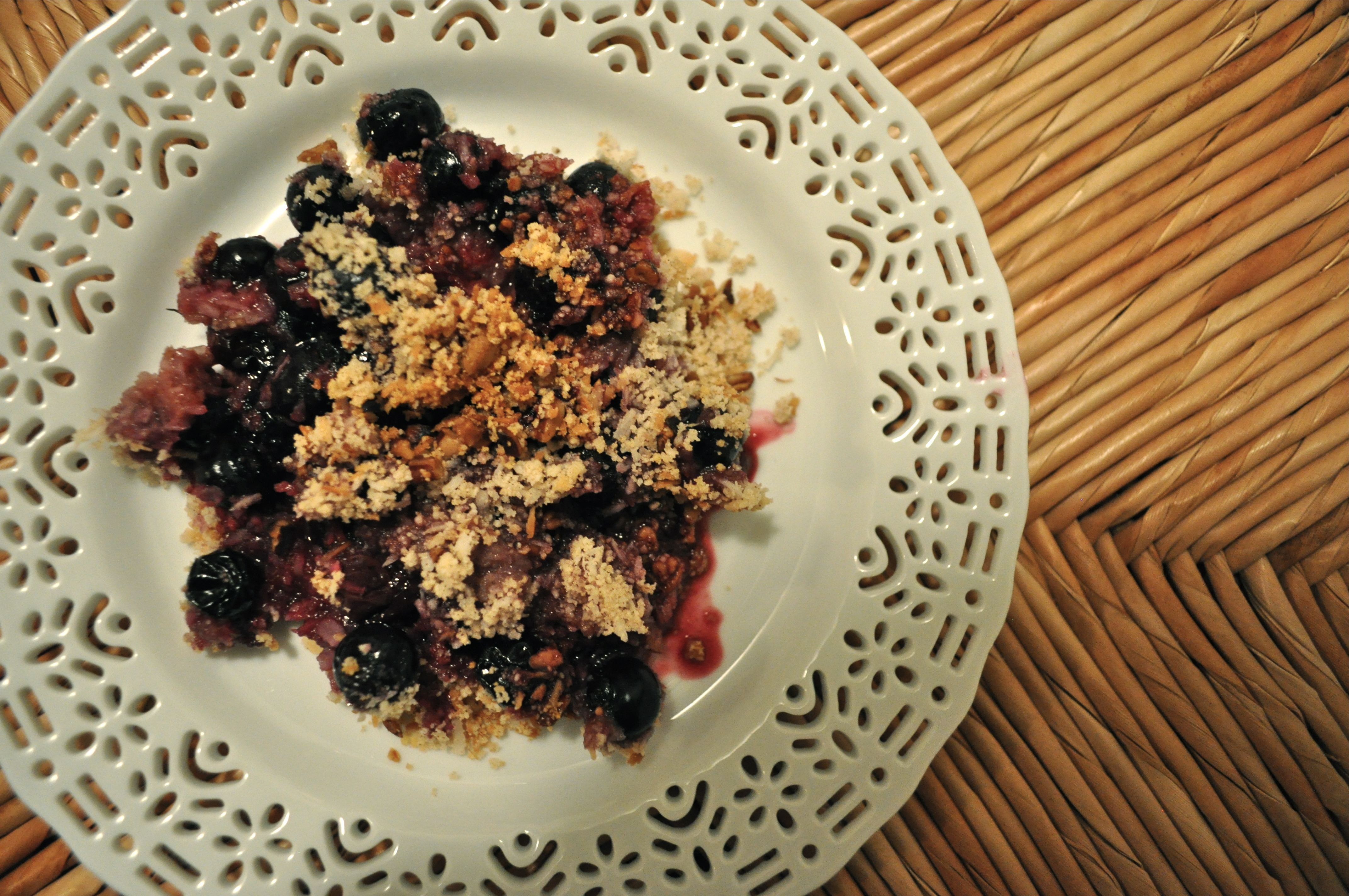 overhead view of a white plate full of Blueberry coconut crumble