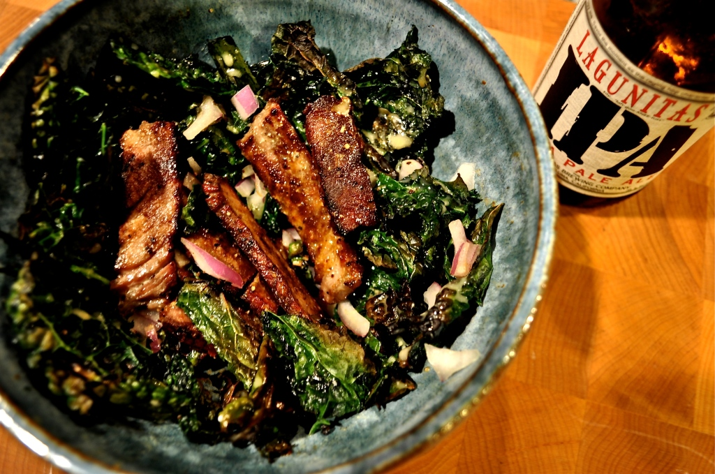 overhead view of crispy kale and steak salad with a pale ale dijon dressing